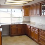 Chocolate cabinets with Ivory Gold countertops