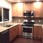 Honey Spice cabinets with Ivory Gold countertops