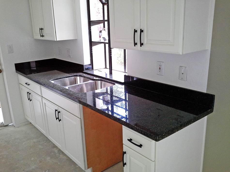 Alpine White Cabinets And Ubatuba Countertops