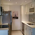 Arctic Shaker White Cabinets and Blanco White Countertops