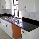 Alpine White Cabinets and Ubatuba Countertops